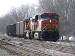 D802 returns to the yard with 6 odd empties from various owners