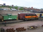 BNSF 2013 Passes an Old BN Caboose