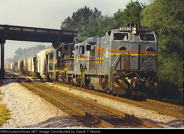 CSX 3002 leads a north bound freight under the old state road 228 bridge