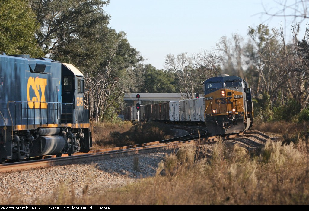 The Juice Train Q740-21 Passes A031-21 Rail Train