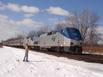 Young railfan waves to eastbound Amtrak passing through CP382