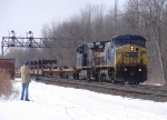 CSX 7909 leading a train of empty stack cars at CP382