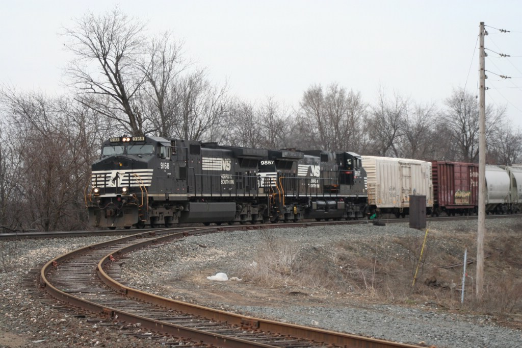 Westbound freight passes the industrial track