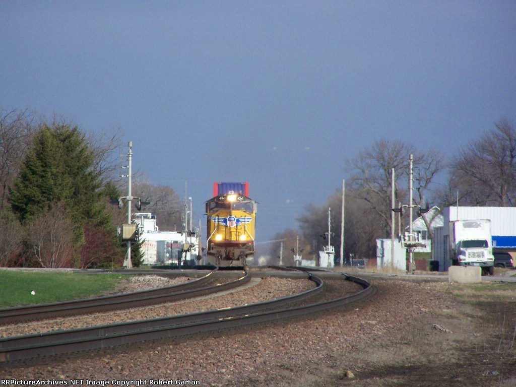 Coming Through a Series of Four Crossings On its Way West, Is a Hotshot Intermodal