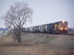 UP 4914 Flies East with a Mixed Freight Consist