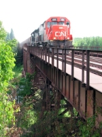 080730004 Northbound DM&IR ore empties crossing Cloquet River