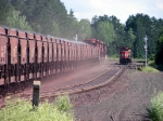 080730073 Southbound DM&IR MinnTac ore loads meet northbound T-Bird light power waiting for crossover movement to Largo