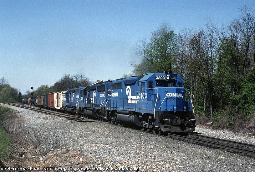 "ENSE (Enola-Selkirk) is passing the severed connection of the old Reading Lines ""Hill Line""  EMD GP-40 3203 is up front"