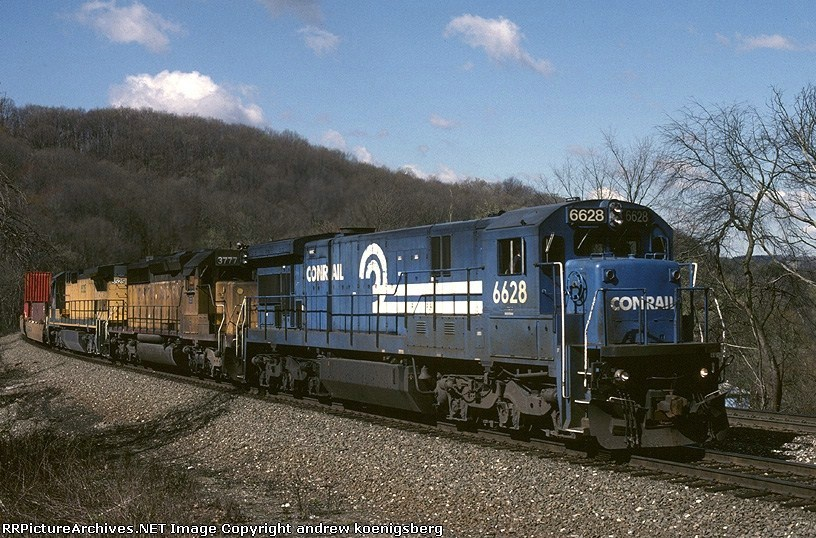 Conrail GE C-36-7 6628 has some off road company as it winds it's way east thru western Pennsylvania