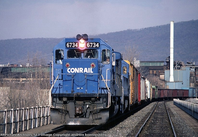 Conrail EMD SD-50 6734 and ALPI (Allentown-Pittsburgh) head west out of town