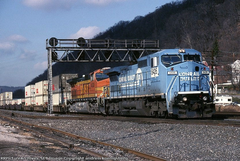 Norfolk Southern GE C-40-8W 8426 blows thru with an eastbound stack train