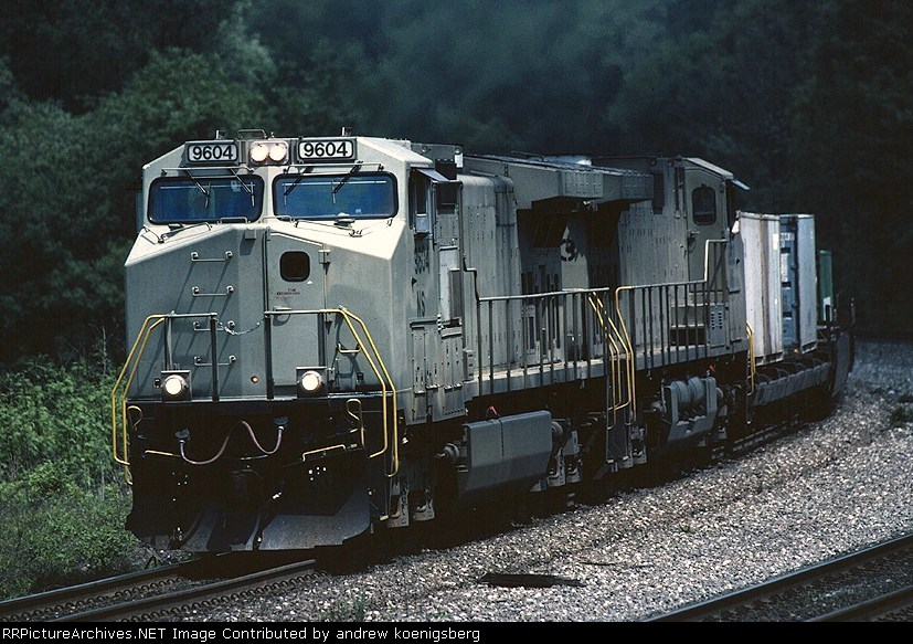 A set of unpainted Norfolk Southern GE C-40-9Ws lift tonnage westbound out of Conway  yard