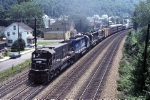 A pair of Conrail U-25-C's are bookends to a pair of SD-45's as they pour on 12,200 horsepower moving eastbound tonnage