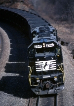 A pair of freshly painted Norfolk Southern (ex Conrail) SD-40-2's are shoving coal eastbound toward the Curve