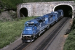 The takeover less than a month old, these blue diesels exiting the tunnel now work for the Norfolk Southern