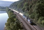 Conrail GP-40-2 3389 leads Mail-3H west along the banks of the Juniata River