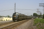 Conrail E-8A 4020 dashes westbound with a short Office Car Special