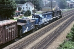 Conrail SD-45 6072 and a still unpainted SD-40 exert 6,600 horsepower in order to keep things moving eastbound towards the Curve