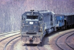 A pair of Conrail (ex-Penn-Central) SD-45's use their dynamics to hold back a coal train as it descends the Horseshoe Curve