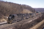 Deep in the heart of the old Pennsylvania Railroad territory, Penn-Central SD-45 6202 and company are slugging it out trying to gain altitude with its huge train stretched out behind