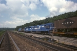 A wide angle lens stretches out this one as Conrail SD-40 6262 rolls west thru Benny interlocking