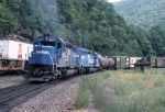 A pair of Conrail SD-40's (ex-CNJ) slowly descend the mountain, while over on track two a Trailvan climbs toward Gallitzin