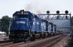 Conrail SD-40 6308 cruises westbound along the old Pennsy main with coiled steel