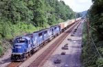 Conrail SD-50 6719 has an endless sting of trailers