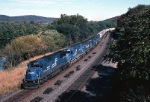 Big power, led by Conrail SD-50 6764, sways along with Mail-9