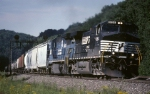 Norfolk Southern C-40-9W 9154 starts into the tight curve with eastbound tonnage