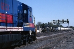 A GECX unit watches Norfolk Southern C-40-9W 9363 lead a piggybacker eastbound thru the crossovers at CP Leets