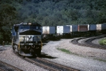 "Norfolk Southern General Electric C-40-9W 9400 rounds the ""big"" curve eastbound with a hotshot intermodal"