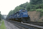 Three Conrail SD-40-2's have traversed the helper return loop at UN interlocking and are returning to Altoona for more work