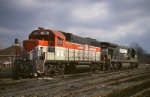 Bangor And Aroostook EMD GP-38 98 and Norfolk Southern GE C-30-7 8024 sit under threatening skies