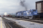 Conrail GE B-23-7 1944 chugs by the old passenger station platform as it makes a run for the Curve