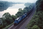 THe morning haze is burning off as Conrail G.E. C-39-8 6018 skirts the banks of the Juniata River with a westbound empty Pittsburgh Power & Lighting unit train