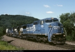 Conrail GE C-40-8W 6106 sweeps around the curve with Mail-4K