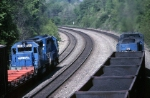 Conrail coming and going on the Middle Dvision. On the left, a set of helpers push a mixed freight, while on the right a coal train heads east