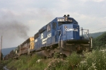 Conrail SD-40-2 6420 and an ex-E-L SD-45 are westbound with mixed freight