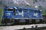 A telephoto lens makes these two Conrail EMD SD-45-2s larger than life as they wait for a signal at SO