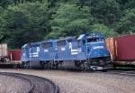 Conrail EMD SD-45-2's are lending an assist to a TrailVan train while a COFC climbs the grade alongside