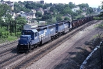A pair of EMD SD-45-2's are drifting by CP SLOPE on the tail of an eastbound coal train