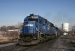 Conrail EMD SD-50 6725 has an empty coal train crossing over at CP Burn and heading west