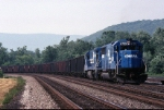 Conrail EMD SD-50 6799 leads a UCR-12 along the finely manicured ex-Middle Division