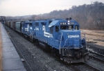 A Conrail local is powered by EMD GP-38-2 8104 and an EMD GP-30