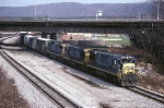 CSX GE B-36-7 5286 ducks under the Conrail mainline as it heads south with a mixed freight