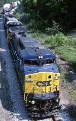 A CSX southbound manifest is underway behind GE C-40-8W 7324 and company