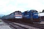 Conrail EMD SD-60 6847 watches Amtrak F-40PH 320 slip by eastbound
