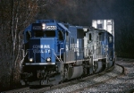 Norfolk Southern EMD SD-70 2563 battles uphill with  a double stack