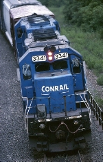 A pair of ex-Conrail EMD SD-40-2's are moving away from the camera as they use their 6,000 h.p. to keep an eastbound moving upgrade